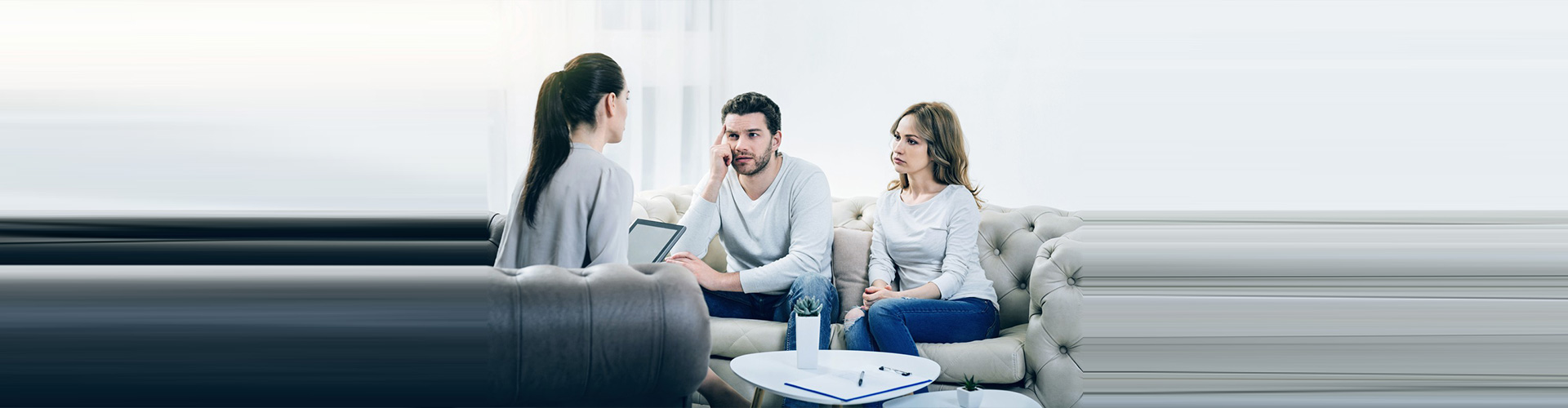 therapist talking to two couple