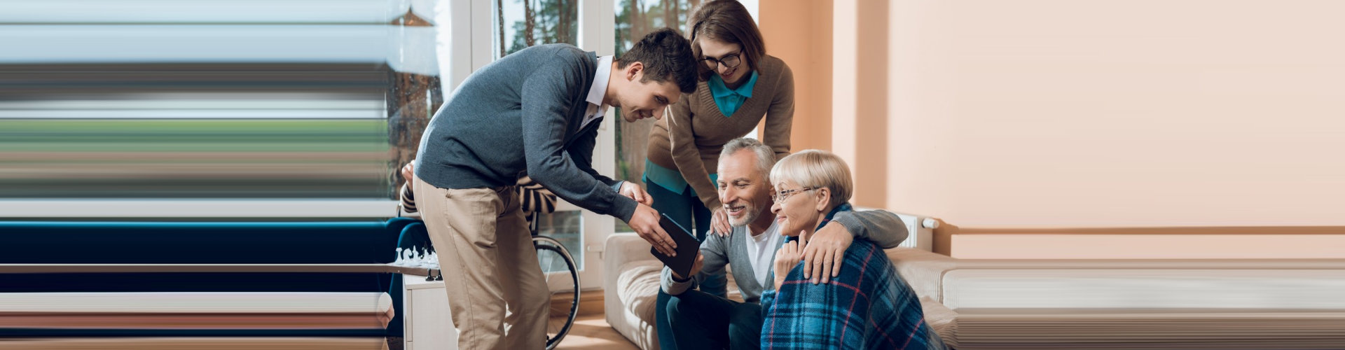 man showing tab to old couple and a woman